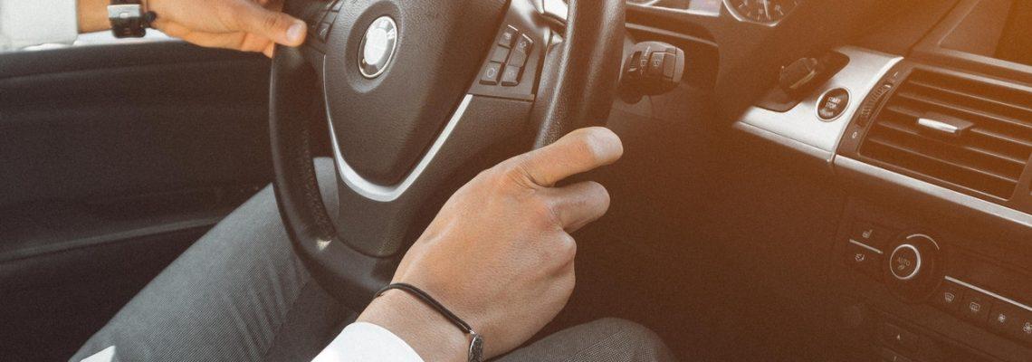 man-in-white-dress-shirt-holding-steering-wheel-804130